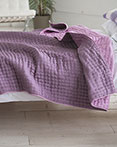 Chenevard Reversible Quilt Damson & Magenta by Designers Guild Bedding