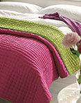 Chenevard Reversible Quilt Fuchsia & Lime by Designers Guild Bedding
