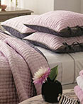 Chenevard Reversible Quilt Rose & Slate by Designers Guild Bedding